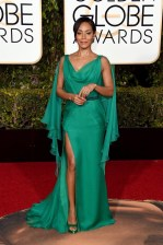 Jada looking as stunning and ageless as ever. This emerald green dress compliments her skin perfectly. Plus you can't go wrong showing a bit of leg