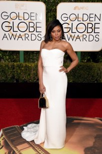 """Taraji P. Henson was on a role with her white hot dress and I must say that bag does the outfit some favours. Her best accessory was the golden globe she """"waited twenty years for"""""""