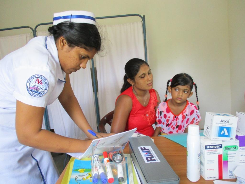 A trainee nurse of Dr. Chamal's observing at Real Medicine Clinic