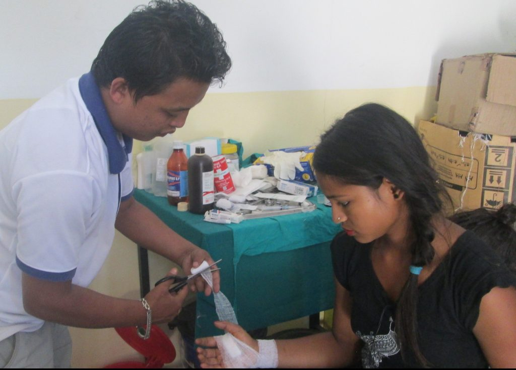 Manisha Katuwal getting her wound dressed