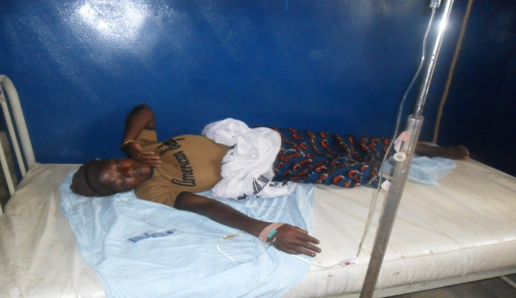 Duwearat Suleima, in labor, lays in bed at the clinic