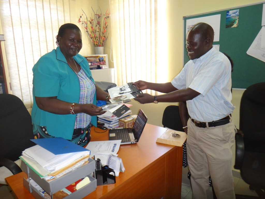 Principal of JCONAM receiving the computer accessories purchased by RMF