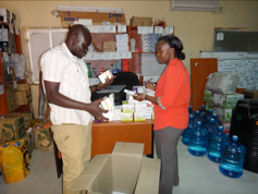 Okang Wilson and Jane confirming quantity and expiry date of medicines
