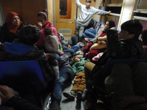 refugees sleeping on train floor