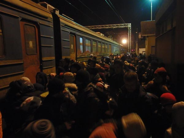 crowd of refugees outside the train