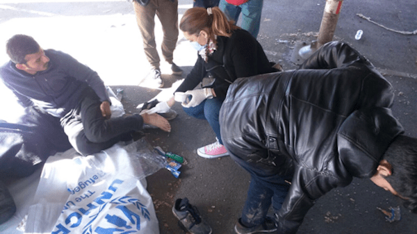 helping a refugee on the street