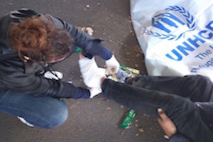 refugees foot being bandaged