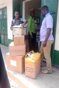staff receiving a package of medication