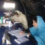 women completing medical paperwork