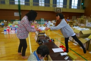 Woman passing out goods