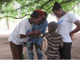 RMF nutrition nurses (in T-shirt) demonstrating to a new recruited CNV how to accurately measure MUAC