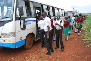 uganda students loading a bus