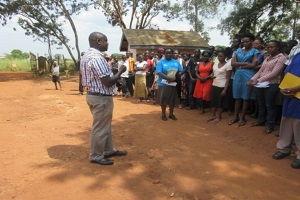 teacher instructing class in uganda