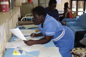 JCONAM nursing student recording the summary of patients' treatment plans following morning ward rounds