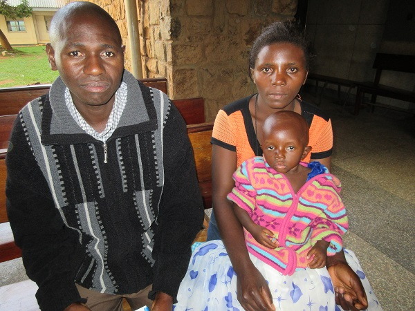 ugandan family with small child