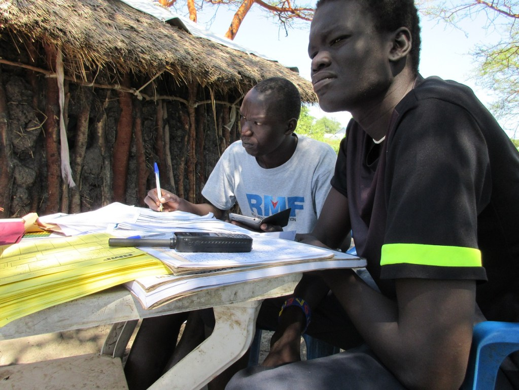 Jiech nutrition team crosschecking the TSFP register before distributing TSFP supplies to the intended beneficiaries