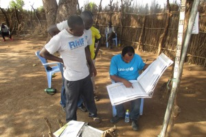 UNICEF nutrition specialist (right) checking RMF OTP register in Boma during a joint UNICEF/WFP M&E visit