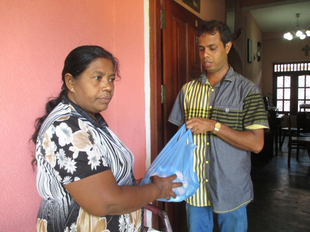 Nishantha gives the food parcel to Madura's mother