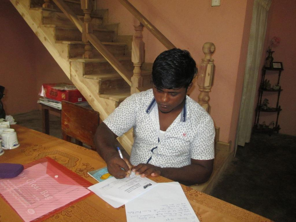 Tharindu signs the document