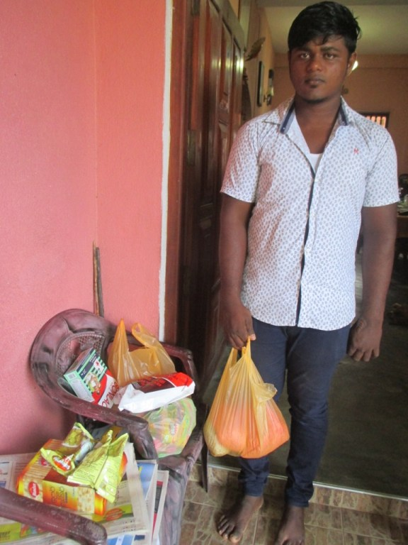 Tharindu with the food parcel