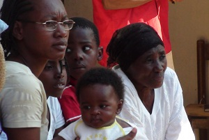 haitian family waiting outside clinic