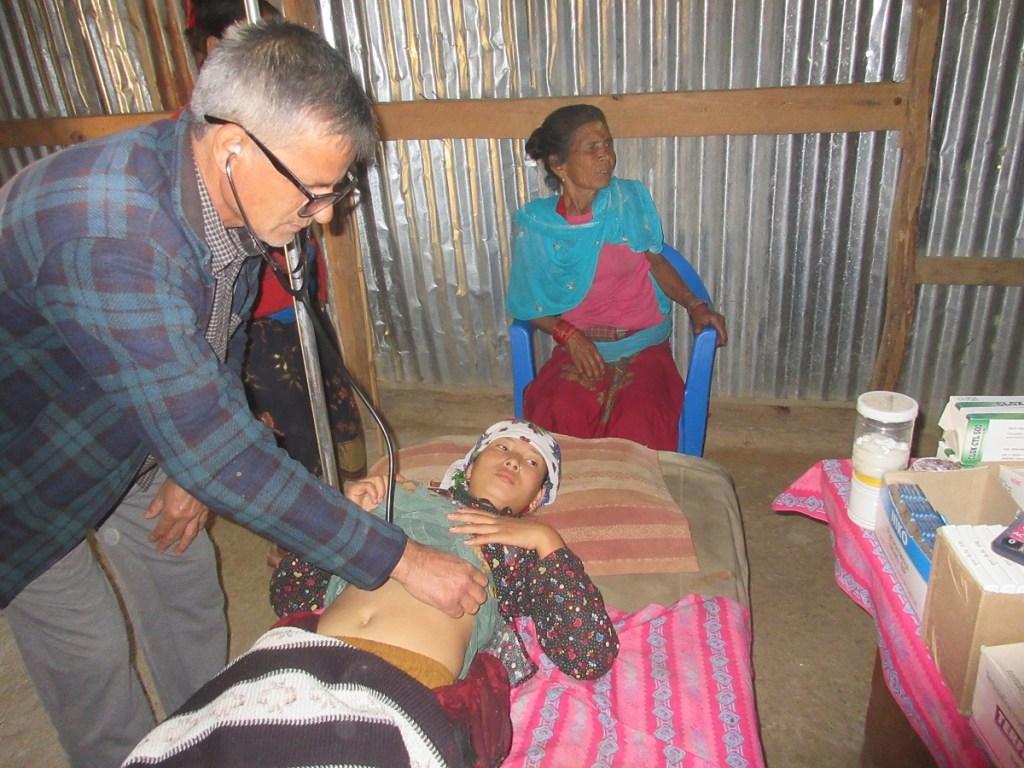 RMF Clinical Officer examining Yunika