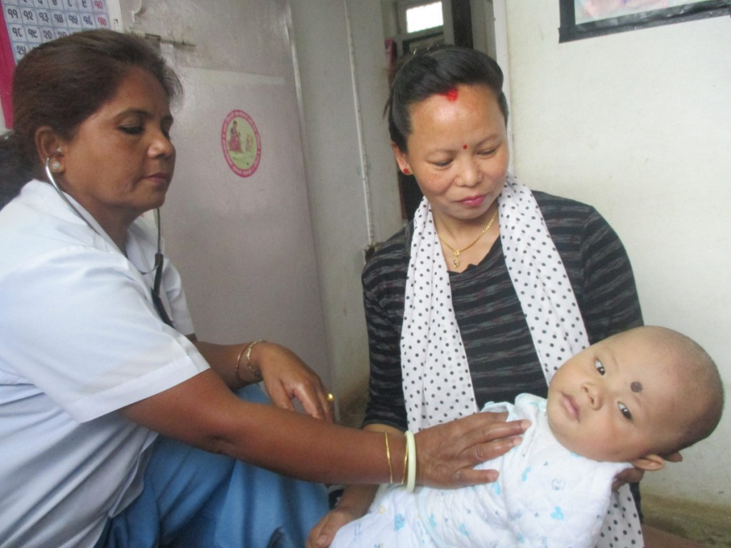 Indu with her son at the Mother & Child Health Clinic