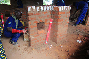 Man laying bricks to build a structure