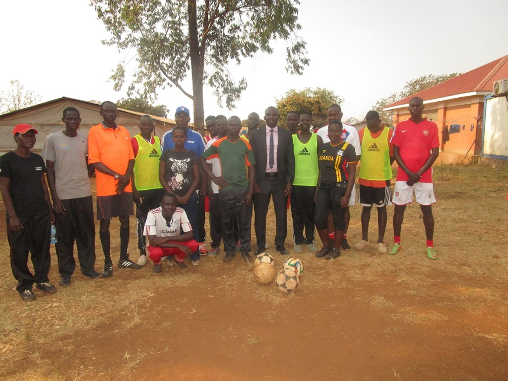 The coaches with Kiryandongo Resident District Commissioner (center right)