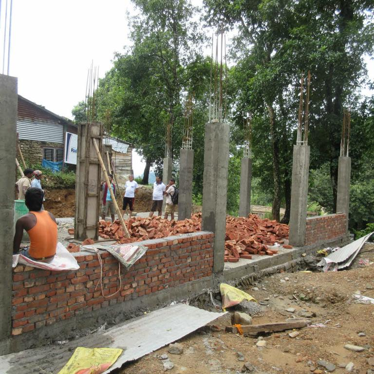 RMF Program Manager and Clinical Officer monitoring construction