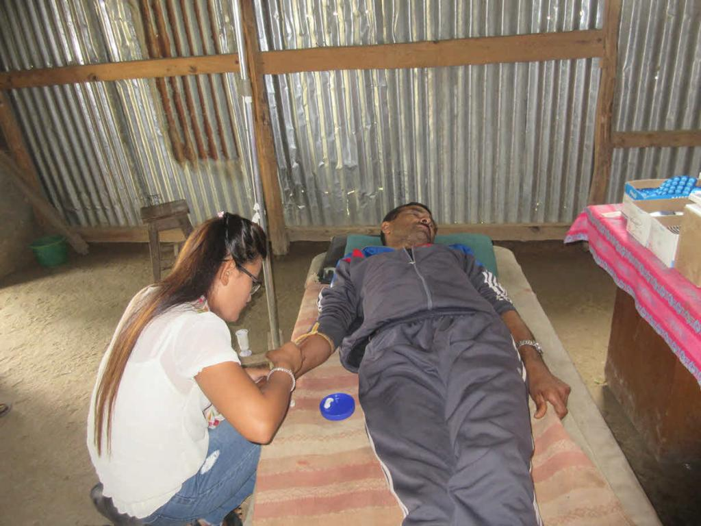 RMF Nurse Laxmi inserts an IV to administer antibiotics for patient Kul Prasad