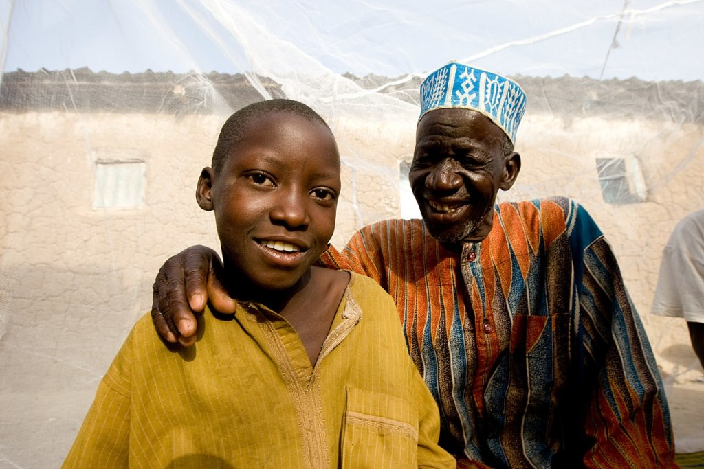 Grandson and grandfather in northern Nigeria, photo by President's Malaria Initiative