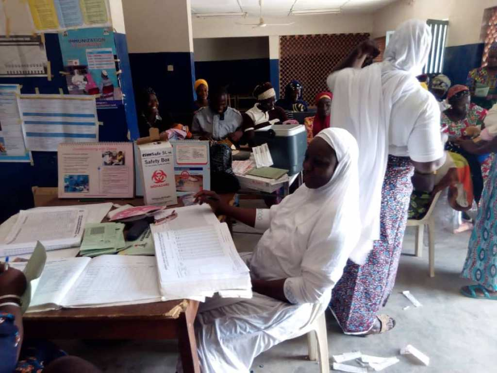 Adama Hajara with other Community Health Extension Workers (CHEWs) and health staff during a routine immunization day at the health facility