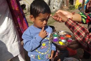 NCO children celebrating the last day of Tihar (Bhaitika) with 7-colored tika