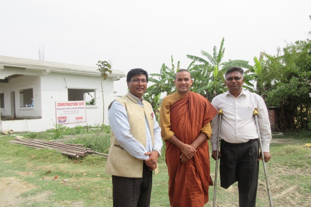 RMF Nepal Program Manager Ganesh Shrestha (left) with the school's founder Venerable Metteyya (center) and Principal Shankar Gautam (right) during a construction monitoring visit