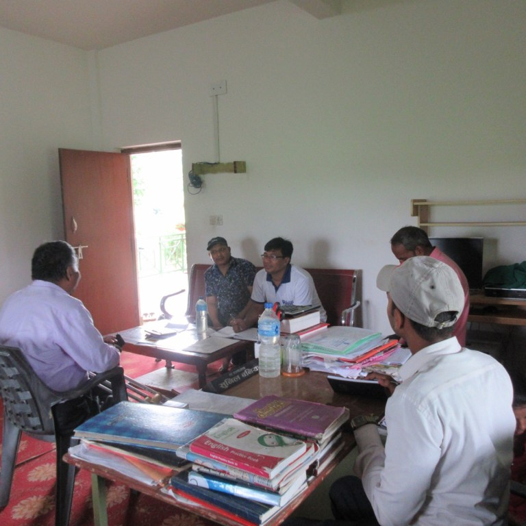 RMF Nepal Program Manager Ganesh Shrestha (center) in a progress discussion with the school principal