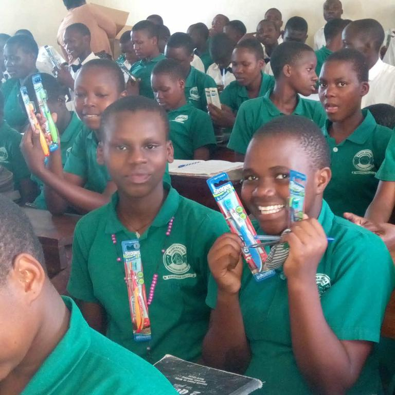 The teachers were at the forefront of distributing the toothbrushes to the students.