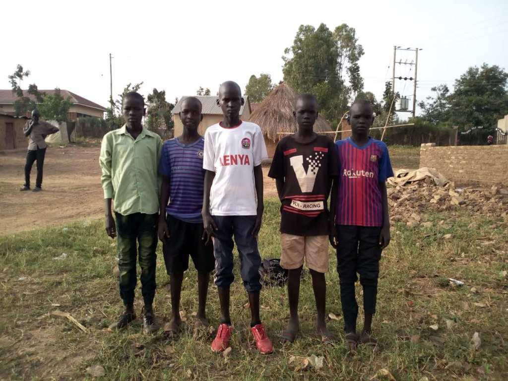 Five (of the six) boys who received scholarships based on their skills and knowledge of soccer.