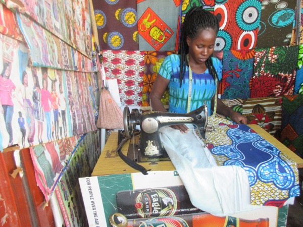 Hellen working on a customer's order of a kitenge dress