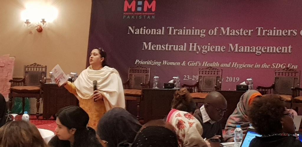 Afshan instructing participants on use of Puberty Book as an advocacy tool for MHM