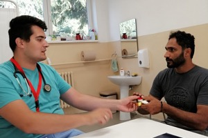 RMF doctor educating a refugee