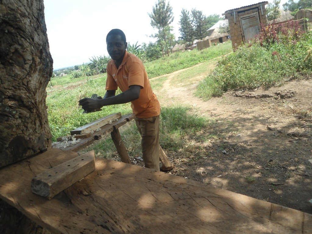 Stanley Sentamu using the carpentry and joinery skills he gained at PVTI to create salable products
