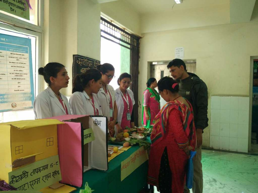 Midwifery students of NAMS explaining about breastfeeding during the exhibition