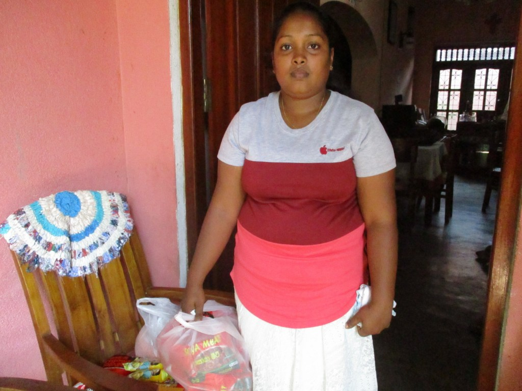 Tharindu's wife with the food parcel