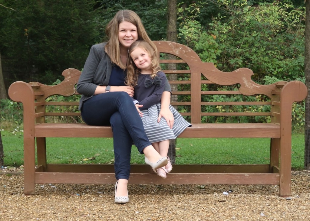 Mummy and Girl sitting on a bench