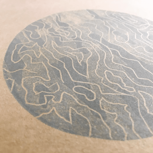"""Before & after: the linoleum & sticker paper from earlier this week have become this spooky, clouded tundra-moon (tundra-planet?) on the cover of Matthew Johnstone's """"Note on Tundra"""""""