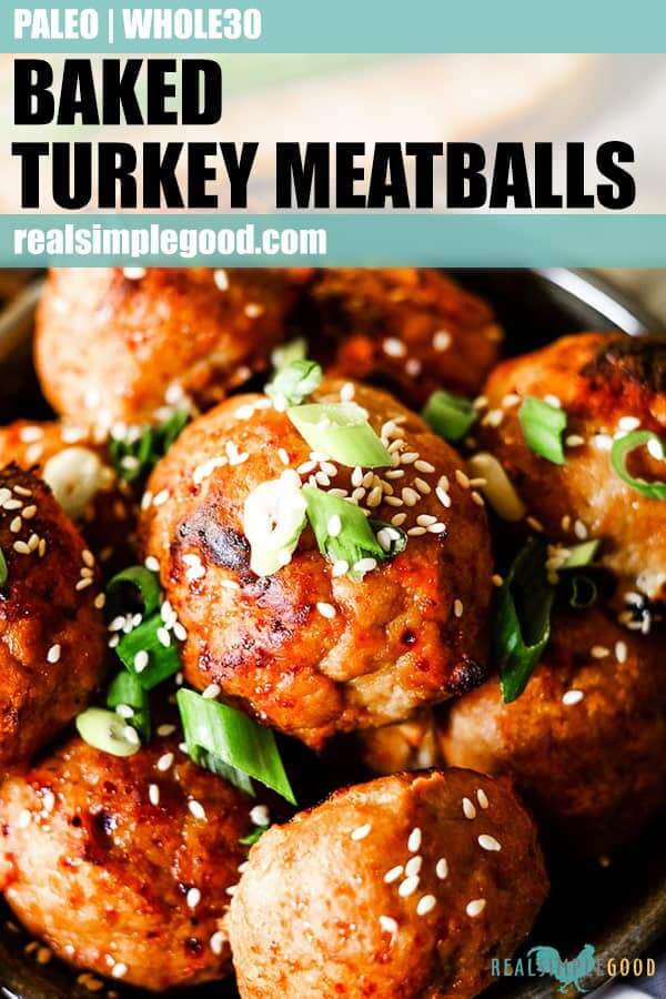 Close up shot of baked turkey meatballs with green onion and sesame seeds long pin.