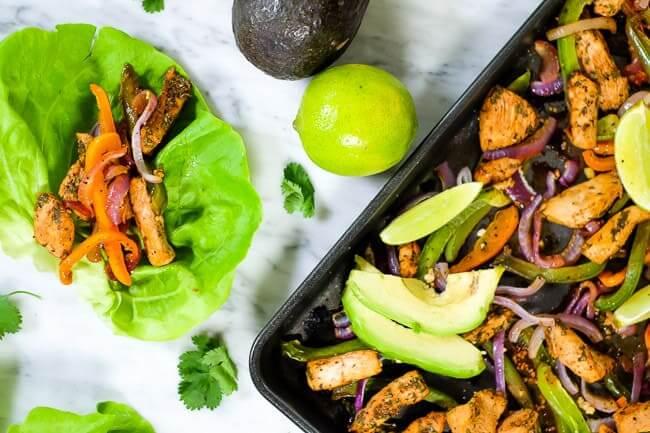 Sheet pan chicken fajita bake with avocado, lime and cilantro. Butter lettuce fajita shells.