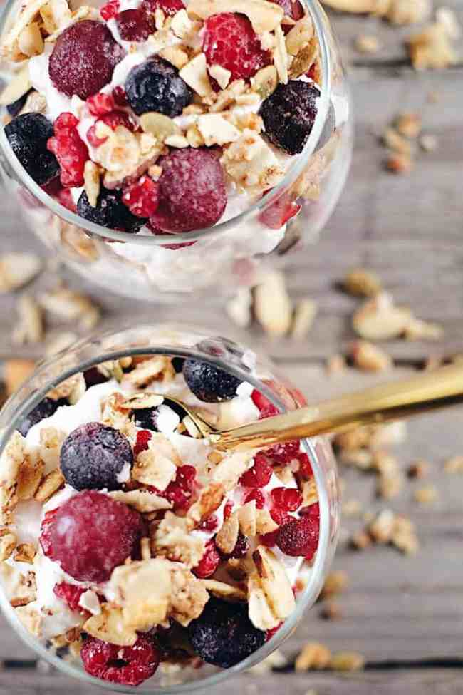 This creamy breakfast parfait is filled with healthy fats from the coconut milk, antioxidant rich berries and grain free granola to add a little crunch. Paleo, Gluten-Free, Grain-Free, Dairy-Free + Refined Sugar-Free.   realsimplegood.com