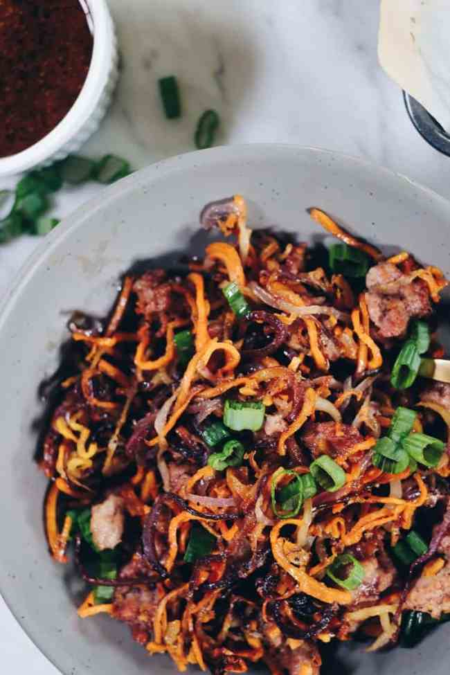 Enjoy the delicious flavors and textures of this Paleo and Whole30 Sheet Pan Crispy Vegetable Noodles and Pork recipe! You will crave the leftovers! | realsimplegood.com